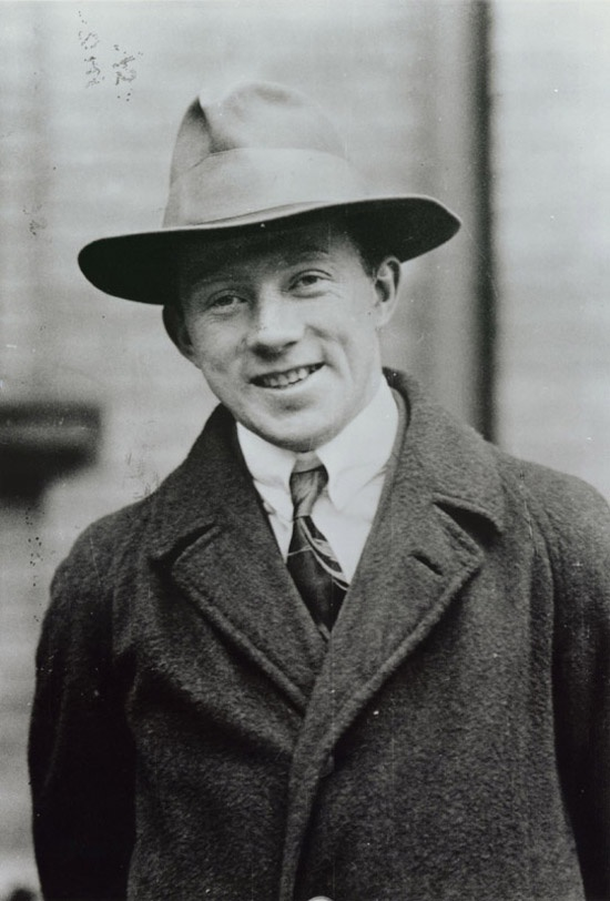 A photograph of a young, smiling Werner Heisenberg.