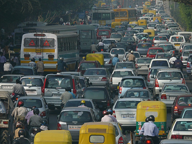Photograph of a road jammed with traffic of all types of vehicles.