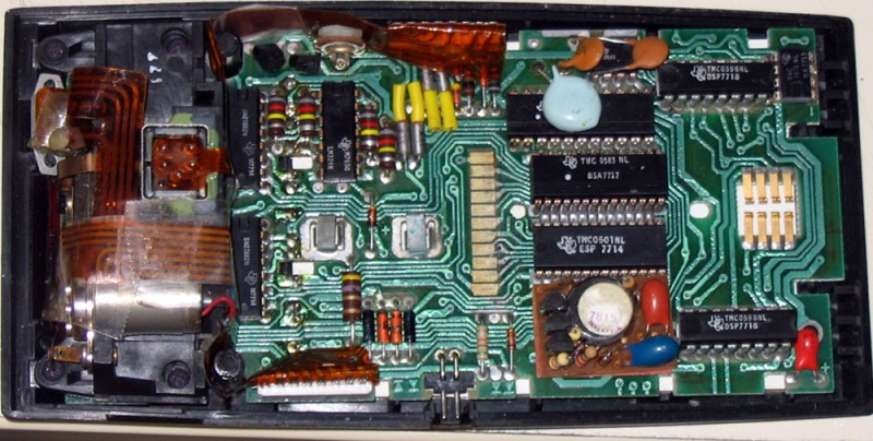 In an electronic calculator circuit the memory is preserved using large capacitors which store energy when the batteries are charged.