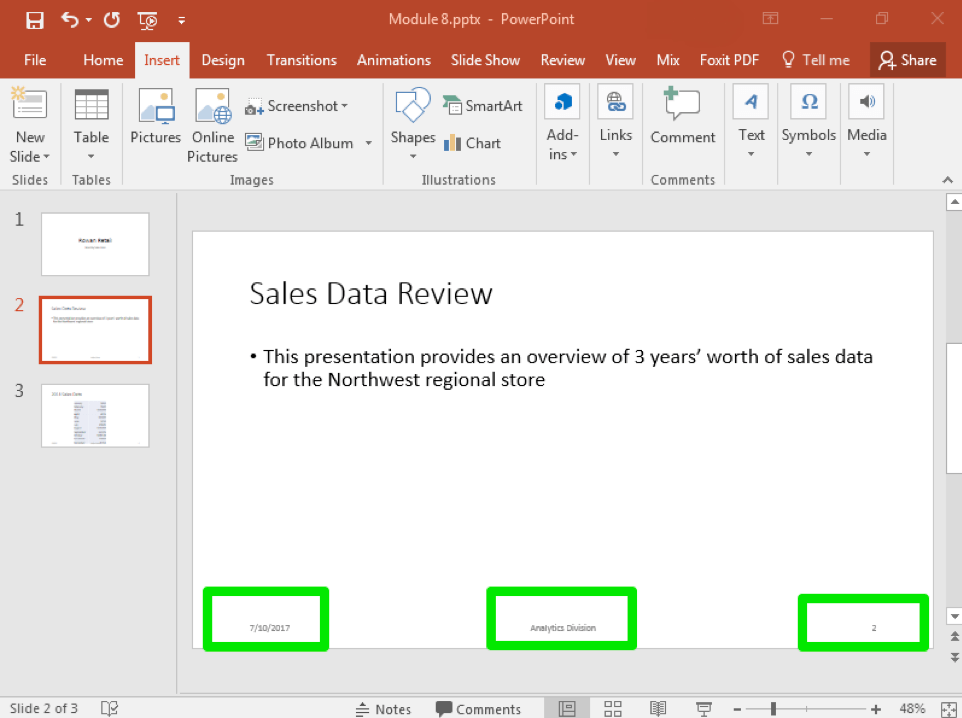 "A Microsoft Powerpoint deck is open with 3 slides created. There are three green boxes on the bottom of the slide showing where the newly inserted options from the header and footer menu are. The box in the bottom left shows the date, the box in the middle shows that the footer has been set to ""Analytics Division"" and the box on the right shows the page number."